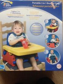 Portable booster/ high chair.