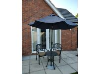 Patio set; table, chairs and parasol