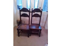 Pair of reproduction Jacobean-style chairs in oak.