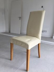 X6 Next faux leather cream chairs