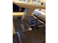 modern -never used dining table and six white leather chairs
