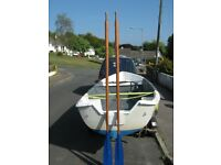A matching pair of 8 foot wooden boat oars