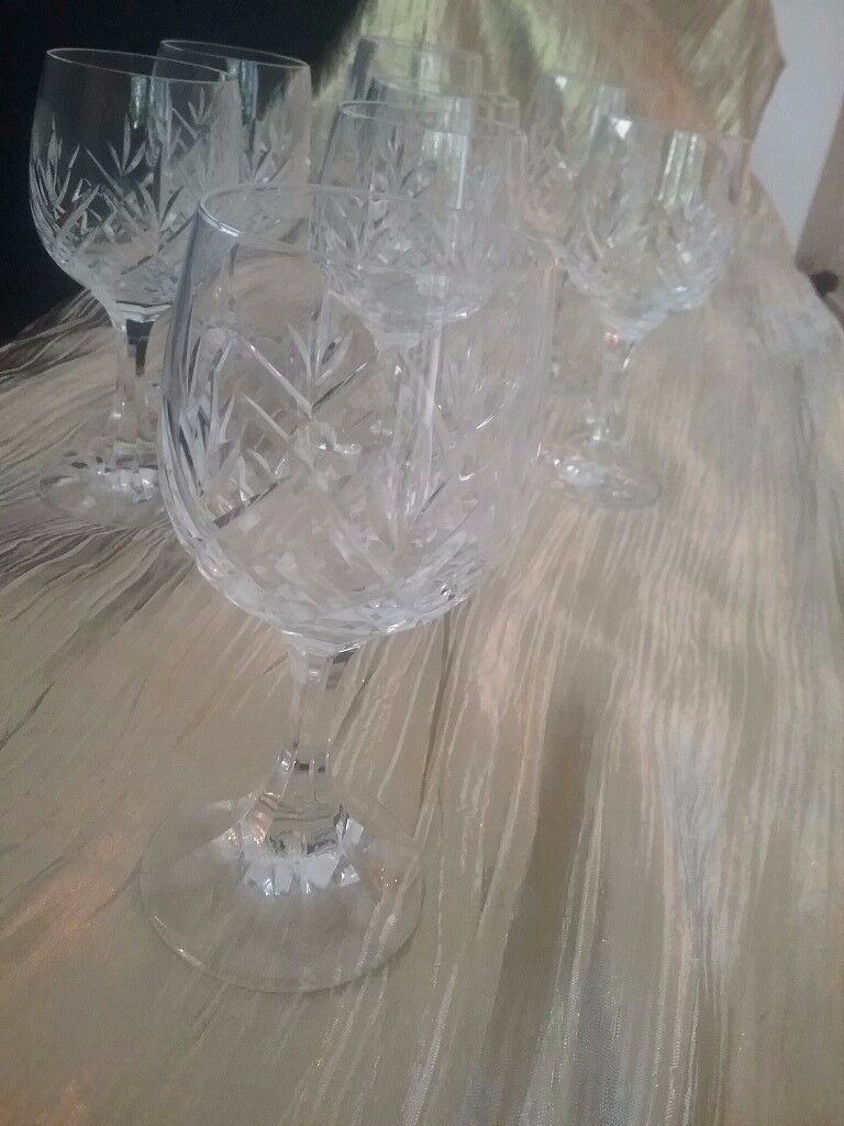 8 wine glasses for the price of 6. 6 matching white wine cut glass plus 2 for red