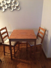 Pine Dinning Table & Two Chairs with Cushions
