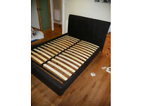 King size, leather covered bed