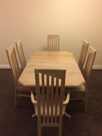 Extendable dinning table and 6 chairs