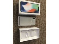 iPhone X 64GB White/silver with £65's worth of accessories.