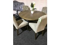 New dark round table and four buttoned chairs