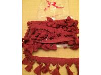 V. V rouleaux raspberry colour curtain fringing