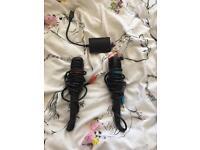 2 Playstation SingStar microphones