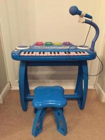 Electronic child's key board with stand and stool