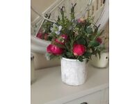 Artificial flower display with stone pot