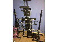 York weight bench with bars, plates and other accessories.