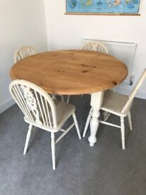 Round drop leaf dining table and 4 chairs. Shabby chic.