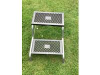 Double caravan step with rubber treads in good condition