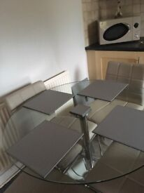 Dinning table and four grey leather chairs from Next excellent condition