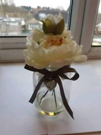 Cream Peonies in a glass jar