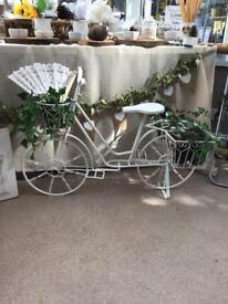Cute metal bicycle used as a wedding prop