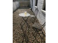 Sold Garden table. Iron table and 2 chairs