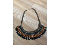 Orange and black tribal statement necklace