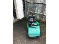 Sulfork petrol lawn mower with scarffer