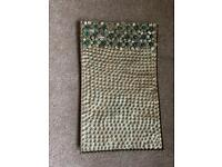 Gold trinket tray with emerald green stones