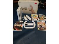 Nintendo wii bundle boxed with 4 games and all accesorys
