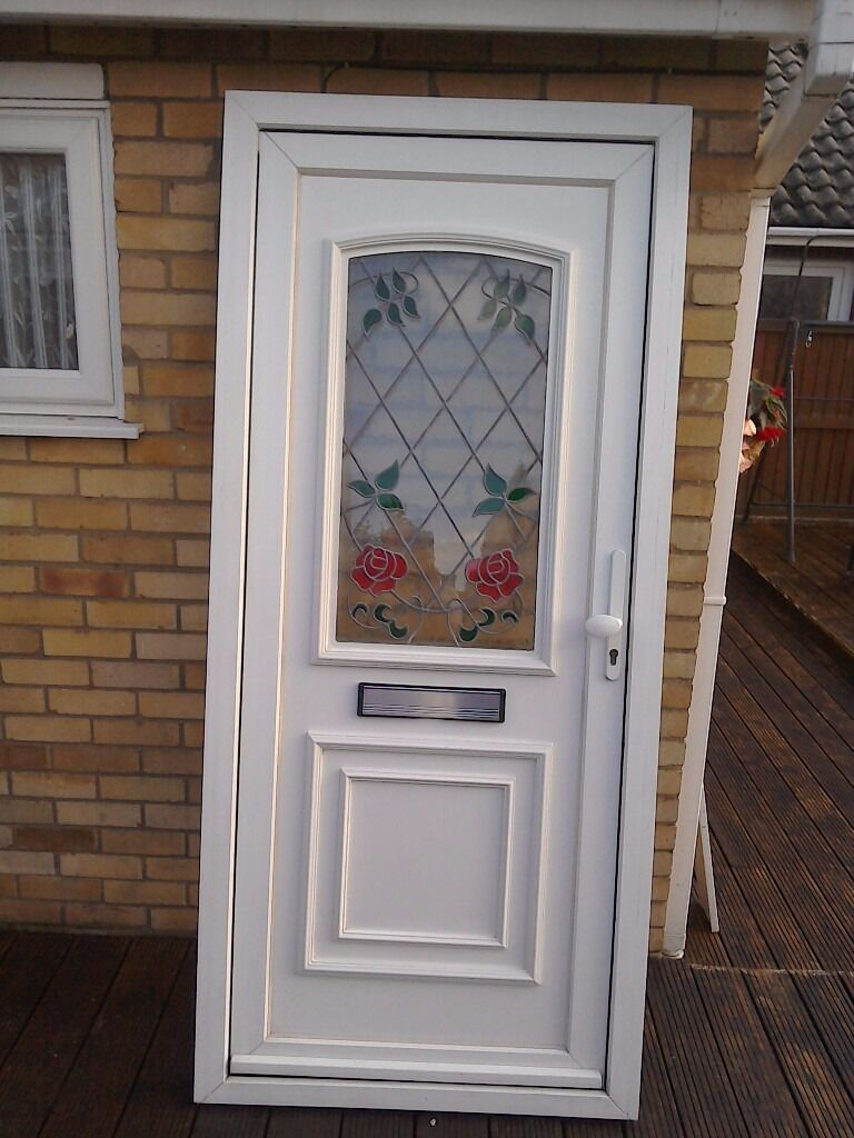 White Upvc Front Door With Leaded Coloured Glass In