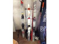 Skis all sizes and boots and poles