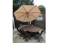 LARGE EXTENDING TABLE *** 8 CHAIRS AND LARGE UMBRELLA***FREE SUN LOUNGERS