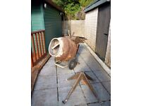 Electric concrete mixer with stand