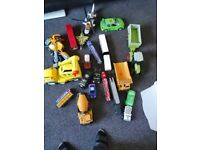 Box of large toy cars