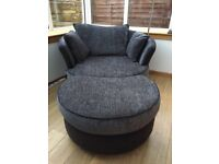 DFS Cuddle chair. Excellent condition. Comes with footstoool and cushions.