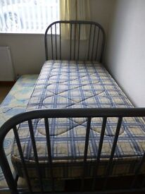 Metal framed single bed with extra pull out bed
