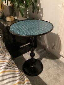 Small unique metal table