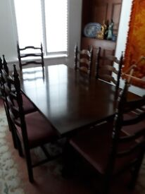 Dining table and chairs. Excellent quality. 6 seater extending to 8 seater with high backed chairs.