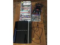 PlayStation 3 console, including 24 games, 2 controllers and Venom charging unit.