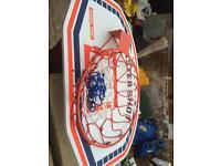 Wall mounted basketball hoop and back board