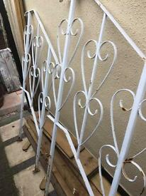 Pair of old ornate handrails for steps with heart design