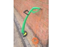 Grass Trimmer, in good condition,very little use, long cable