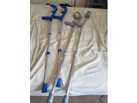 2 pairs of crutches one brand new and the other used for a few weeks