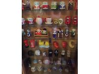 Cabinet filled with collectible salt or pepper pot.
