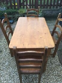 Solid Pine Dining Table And Four Chairs 4ft long x 2ft 3inch wise.