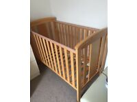 Cot with scratch otherwise in good condition/Matress in excellent condition/two sheets and duvet