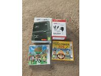 Nintendo 3ds XL in matalic black, with game charger and two games