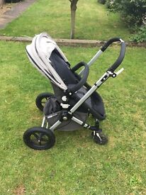 Bugaboo Cameleon with 2 fabric sets, summer canopy and more.