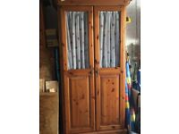 An Antique Solid Pine Double Wardrobe with half glass doors.