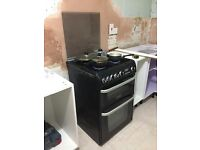 Four stoves Cannon make Gas cooker with oven/grill, a tumble dryer , microwave and fridge freezer.