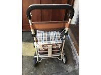 Four wheeled shopping Walker with seat/storage