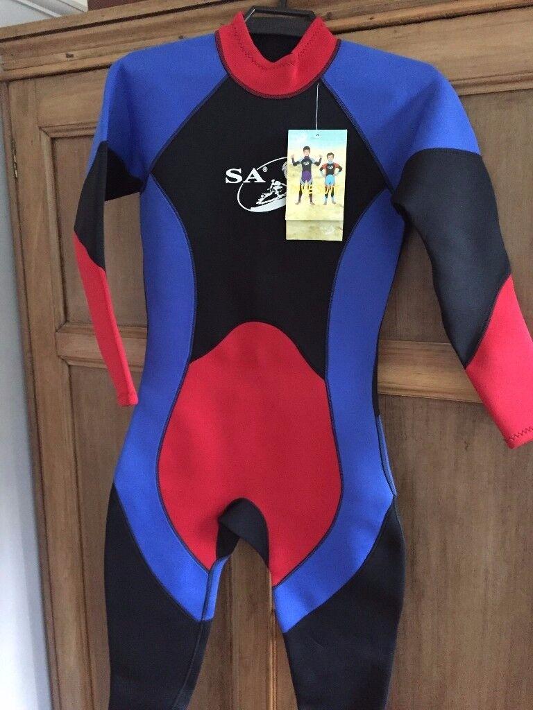 "Wet suit, Child XL, Age 12-13, chest 34"" unused, still has label."